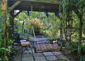 swing hanging from arbor