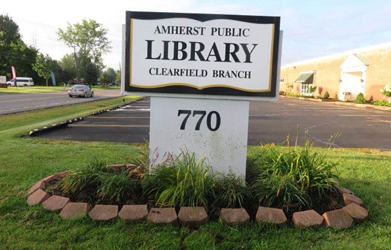 plants surrounding Clearfield Library sign