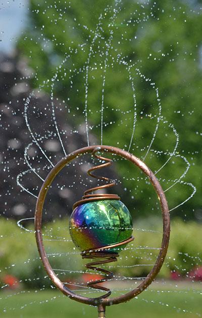 sprinkler in summer by Stofko