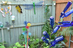 blue bottles, painted allium and other garden ornaments