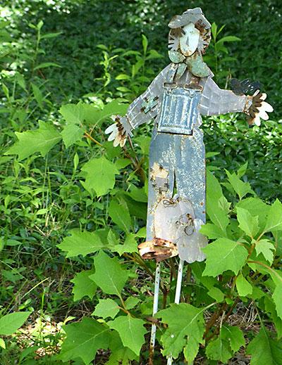 metal scarecrow in garden