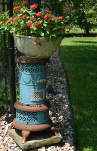 old oil heater is pedestal for annuals