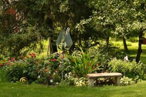 stone bench by garden