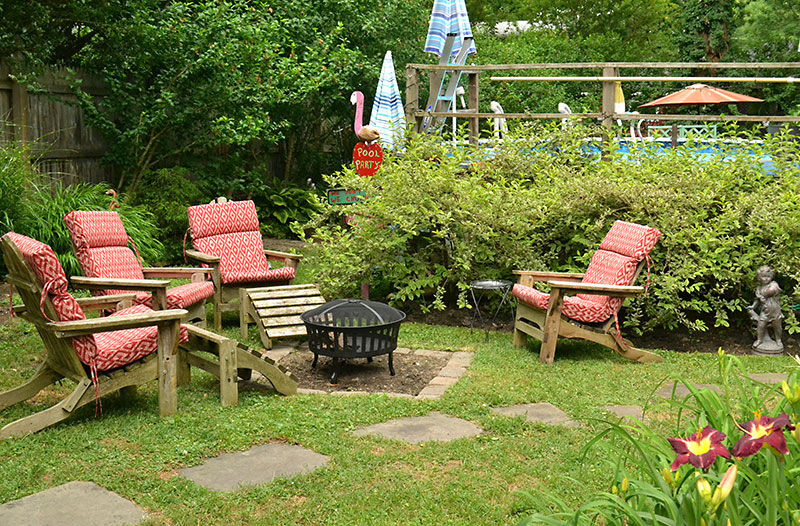 chairs in yard with gardens