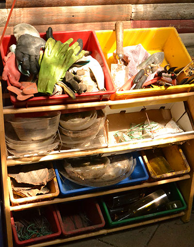 use toy bins as storage in garden shed