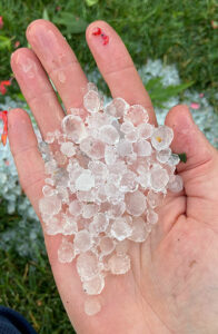 hand holding hail in Snyder NY